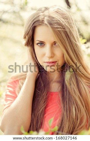 Portrait of young beautiful blond woman outdoors - stock photo