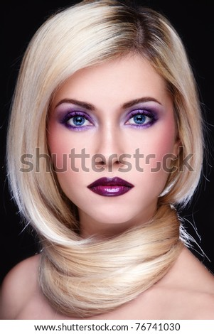 Portrait of young beautiful blond woman with stylish violet make-up - stock photo