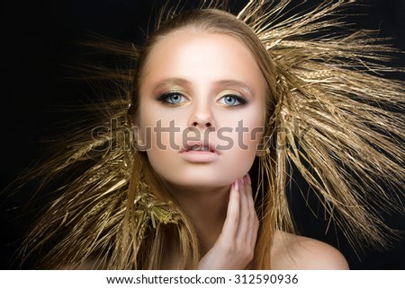 Portrait of young beautiful blonde girl with golden ears wreath. Autumn and yield concept. - stock photo