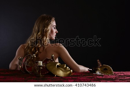 Portrait of young beautiful blonde with a gold Venetian mask - stock photo