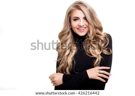 Portrait of young beautiful blonde woman with long curly hair and glamour makeup. Girl looking at camera. White background. Black and white style. - stock photo