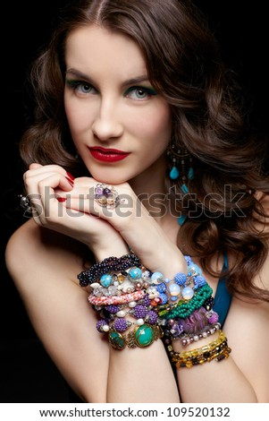 portrait of young beautiful brunette woman in jewellery - stock photo