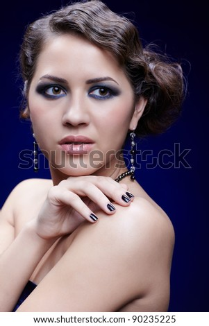 portrait of young beautiful brunette woman in jewellery with manicured fingers - stock photo