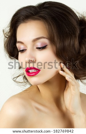 Portrait of young beautiful brunette woman touching her face - stock photo