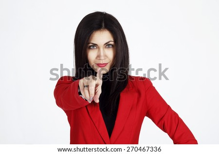 Portrait of young beautiful business woman in red jacket showing at you - stock photo