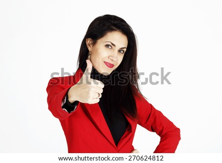 Portrait of young beautiful business woman in red jacket showing showing hand ok sign - stock photo