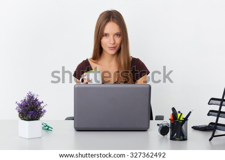 Portrait of young beautiful business woman working at her office. - stock photo
