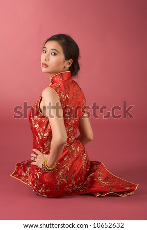Portrait of young beautiful Chinese female in traditional clothes (cheongsam)
