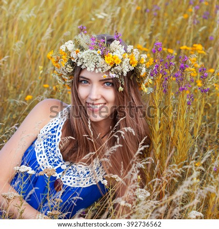 Portrait of young beautiful cute romantic  girl wearing a wreath of wild flowers in summer day, outdoors. Happy woman. Series of photos