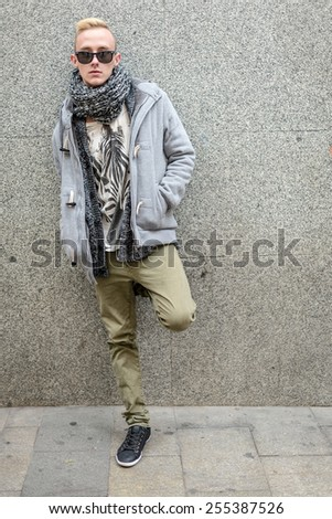 Portrait of young beautiful fashionable man in the street - stock photo