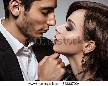 portrait of young beautiful flirting couple in love. close-up - stock photo