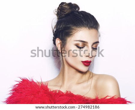 Portrait of young beautiful girl.Beautiful woman face.Perfect toothy smile.Red lips,skin,teeth.Isolated on white background. Studio shot .Happy positive girl.Fashion pink clothes.  - stock photo