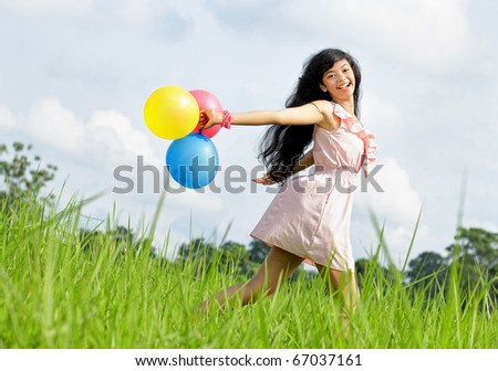 Portrait of young beautiful girl in field