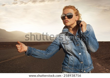 portrait of young beautiful girl in sunset road environment  - stock photo