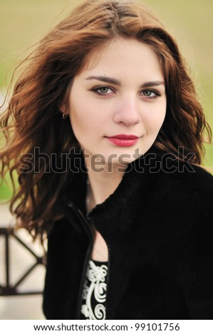 Portrait of young beautiful girl in windy weather - stock photo