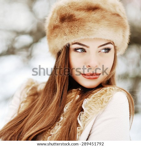 Portrait of young beautiful girl in winter close up  - stock photo