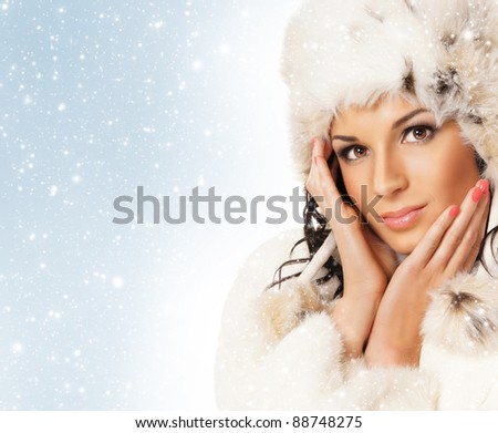 Portrait of young beautiful girl in winter style over background with snow - stock photo