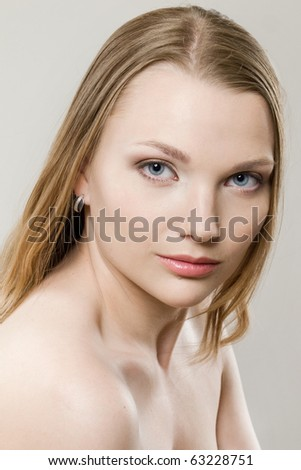 portrait of young beautiful girl on grey background