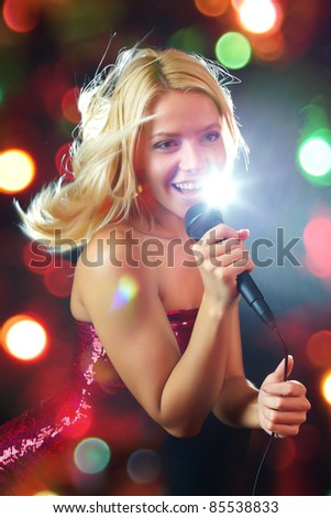 Portrait of young beautiful girl singing