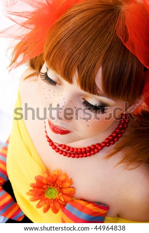 Portrait of young beautiful girl with artistic makeup