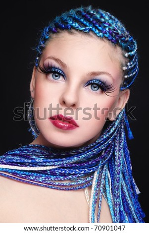 Portrait of young beautiful girl with fancy blue hairstyle and extra long fake eyelashes - stock photo