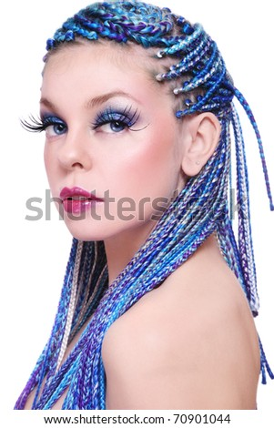 Portrait of young beautiful girl with fancy blue hairstyle and extra long fake eyelashes, on white background - stock photo