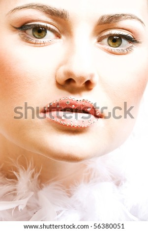 Portrait of young beautiful girl with sparkle on her lips