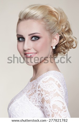 Portrait of young beautiful happy smiling blonde bride - stock photo