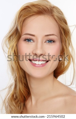 Portrait of young beautiful happy smiling girl with curly hair and clean make-up - stock photo