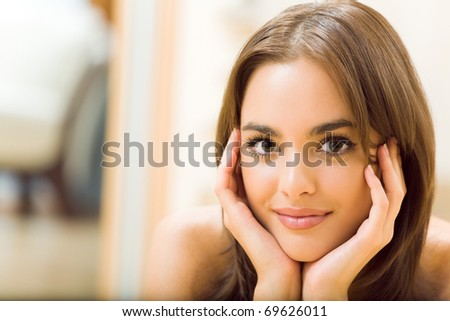 Portrait of young beautiful happy smiling woman, at home - stock photo