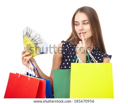 Portrait of young beautiful happy woman with euro banknotes money and many colorful shopping bags isolated on white background - stock photo