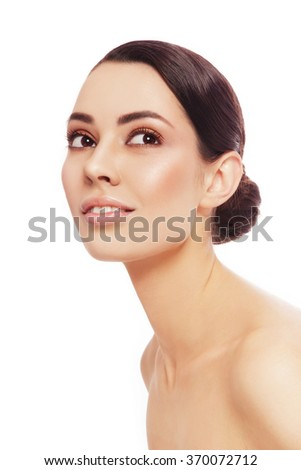 Portrait of young beautiful healthy happy woman looking upwards, over white background - stock photo