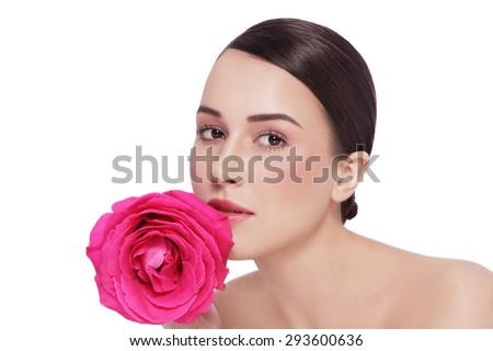 Portrait of young beautiful healthy woman with fancy pink rose over white background - stock photo