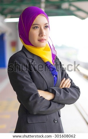 Portrait of young beautiful Muslim wearing suit - stock photo