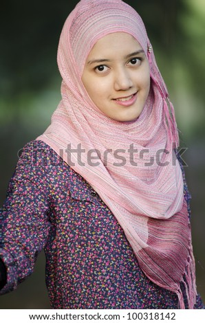 Portrait of young beautiful Muslim woman.
