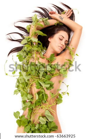 Portrait of young beautiful nude woman with green ivy leaves wrapped around her on white background - stock photo