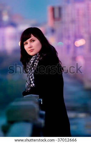 portrait of young beautiful ???? on the city background - stock photo
