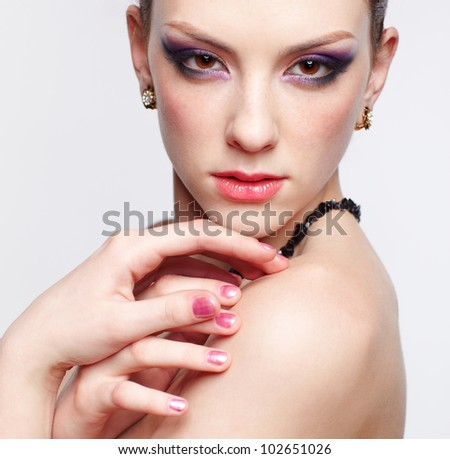 portrait of young beautiful redhead woman touching putting her manicured hands over her shoulder - stock photo