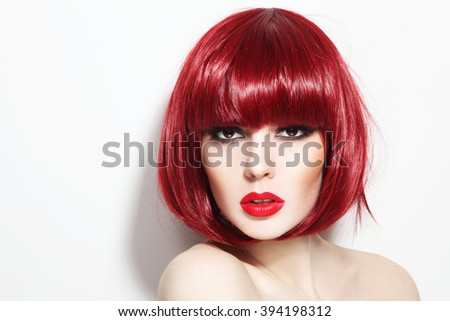 Portrait of young beautiful sexy red-haired girl with bob haircut and stylish make-up - stock photo