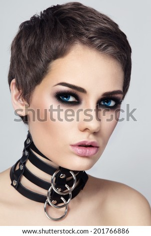 Portrait of young beautiful sexy woman in black leather collar  - stock photo