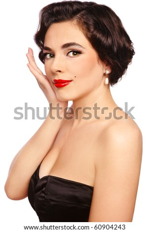 Portrait of young beautiful sexy woman in vintage bra with glamorous make-up and hairstyle, on white background - stock photo