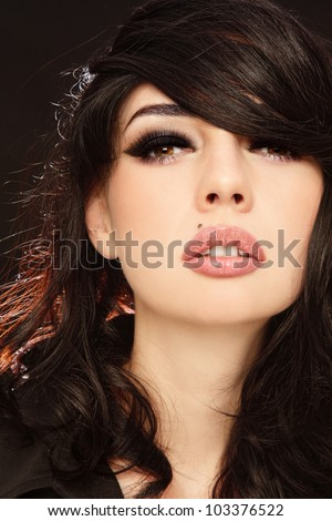 Portrait of young beautiful sexy woman with stylish make-up, focus on eyes - stock photo