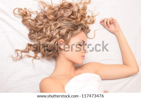 portrait of young beautiful sleeping woman - stock photo