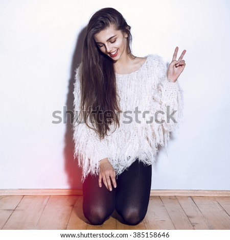 Portrait of young beautiful smiling girl.Beautiful woman face.Perfect toothy smile and long hair.Isolated on white background.Studio shot.Happy positive lifestyle.Fashion clothes home style.Hipster.