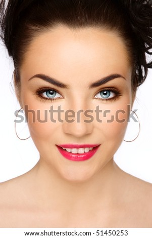 Portrait of young beautiful smiling girl with stylish make-up - stock photo
