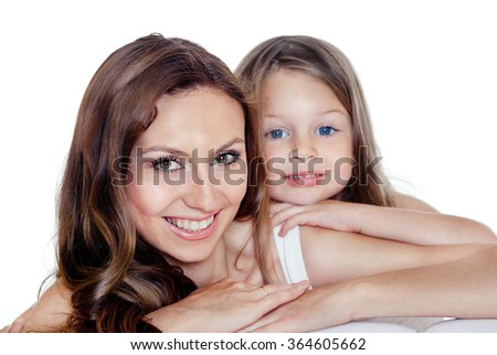 Portrait of young beautiful smiling mother and preschool daughter with blue eyes - stock photo