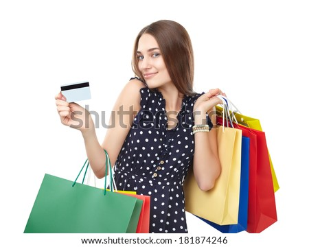Portrait of young beautiful smiling woman with credit card and many colorful shopping bags isolated on white background