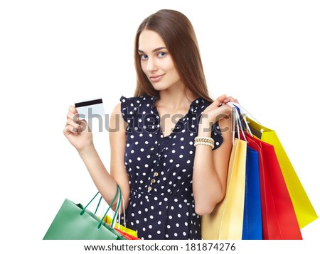 Portrait of young beautiful smiling woman with credit card and many colorful shopping bags isolated on white background - stock photo