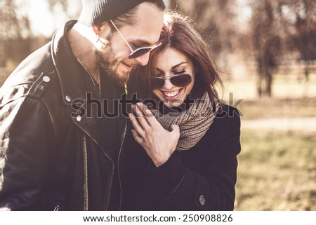 portrait of young beautiful stylish couple  in autumn park - stock photo