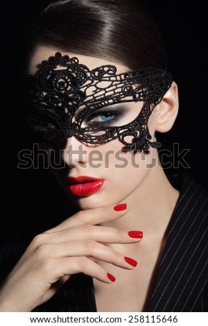 Portrait of young beautiful stylish woman in black lacy mask - stock photo